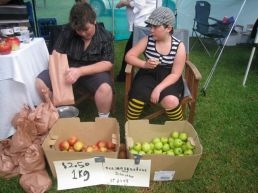children selling organic apples