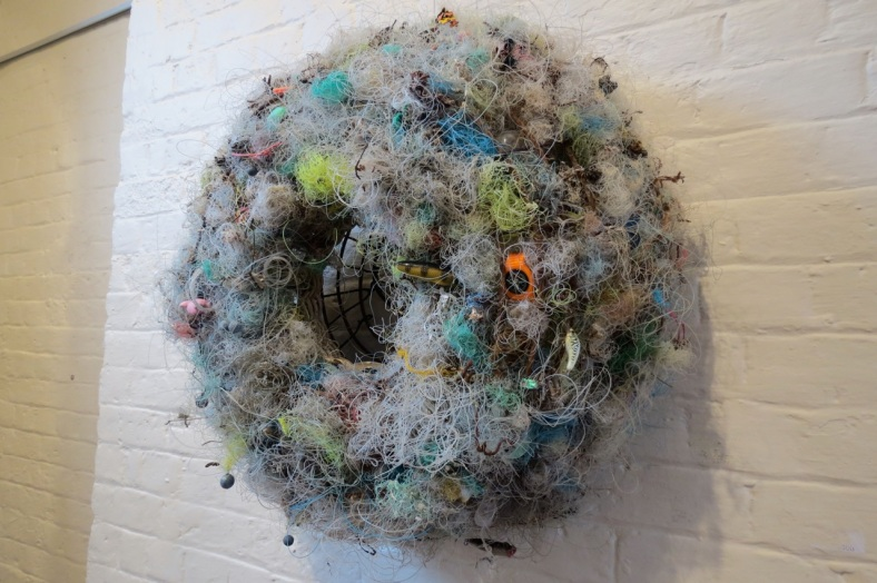 """Between the Lines"" by Judy Malonvay, made from lobster pot, tangles of fishing lines, shaark egg, shell andmanmade litter reclaimed from Cullendulla Creek over 4 years."