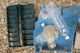 tackle box, bottles, plastic pieces, broken bucket