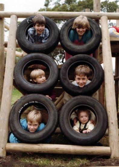 cousins long ago peeping through tyre climbing frame