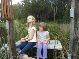 cousins on bench by the dam