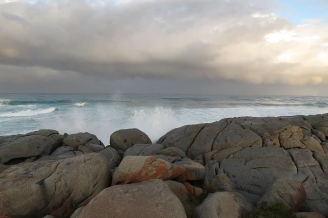 steady rocks, wild seas
