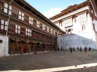 monastery courtyard, dancers and onlookers