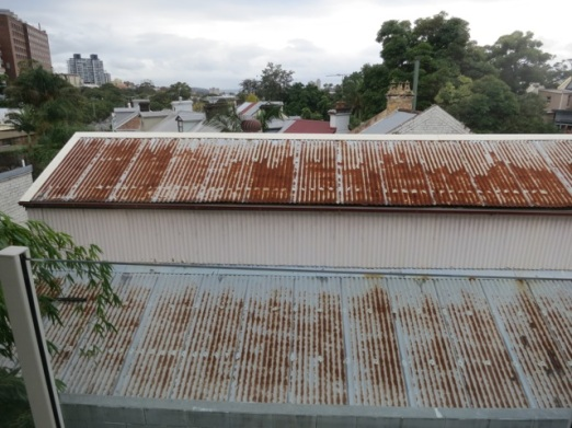 corrugated iron roof and view towards harbour