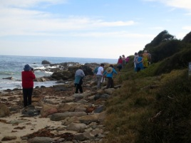 walking over the rocks to find the little cove