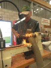 demonstrating woodturning by making tops