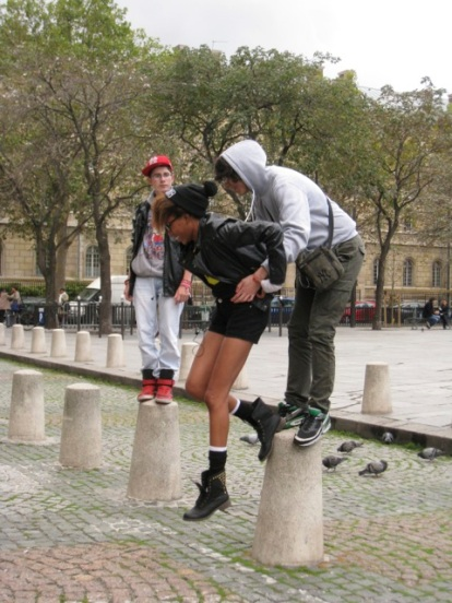 balancing on the bollards Place St Sulpice