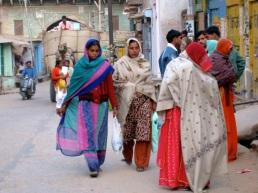 women shopping, camel cart behind