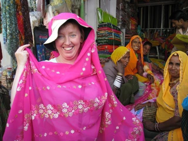 English friend buying pink sari, Rajasthan