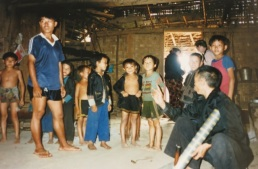 medicine man and children Ban Houay Nor Hom, Hmong people